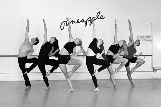Black and white photograph of dancers in a studio practicing