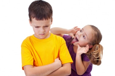 A girl jeers at her brother.