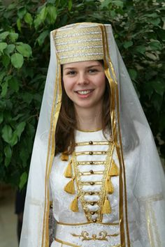 and happily wearing a traditional Kabardian dress later on Girl  Pictures, Grand