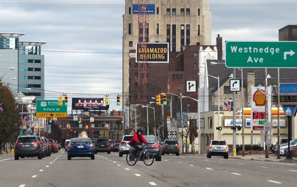 A bicyclist crosses the street in downtown Kalamazoo in this MLive File  Photo. (Mark