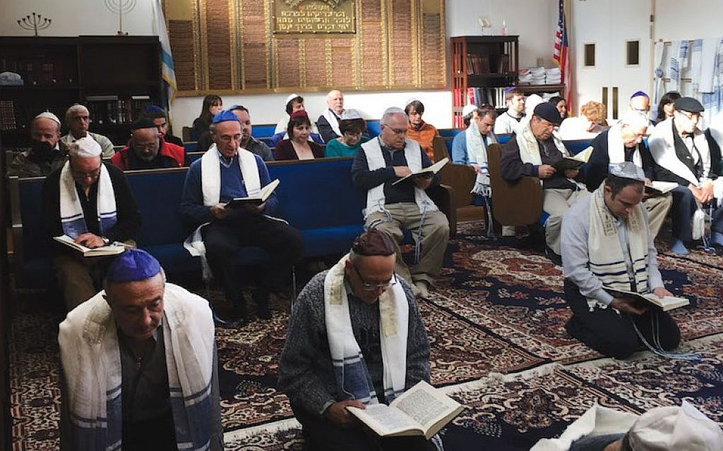 It is a custom among Karaite Jews to pray kneeling on the ground, as seen
