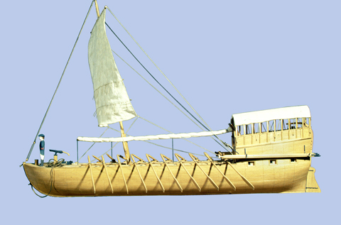 scale model of a wooden, masted boat