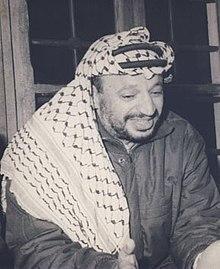 Yasser Arafat wearing his iconic fishnet pattern keffiyeh in 1974