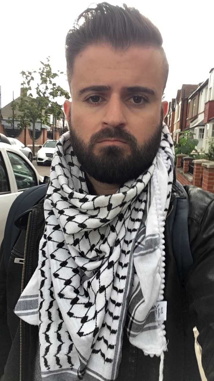 The author, Elias Jahshan, proudly wears his Palestinian-made keffiyeh