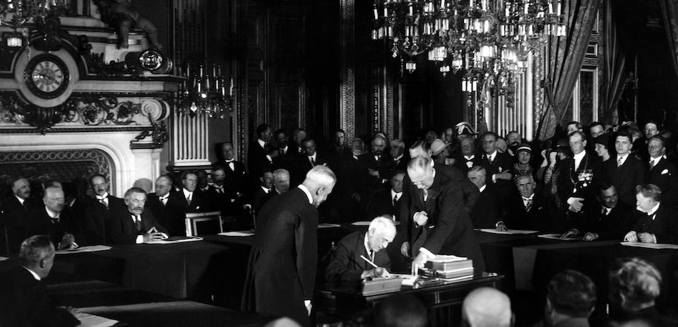 US Secretary of State Frank B. Kellogg signs The Kellogg Briand Pact (or  Pact