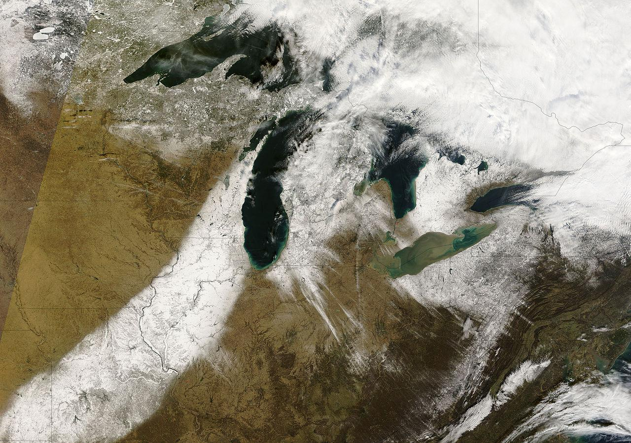 Streaks of snow stretching across the Great Lakes captured by a NASA  satellite on Dec.