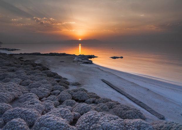 NO LONGER RECEDING — The sun sets over the salt-encrusted beach of Lake  Urumiyeh